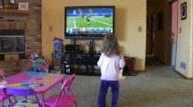 Young girl named Grace mimicks NFL Combine in livingroom